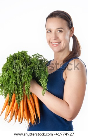 A young woman with a bunch of ripe carrots on a white background - stock photo