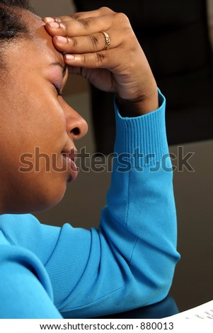 A young woman with a headache. - stock photo