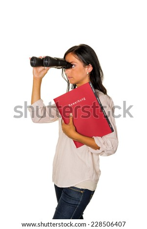 a young woman with a job application on the lookout for a job - stock photo