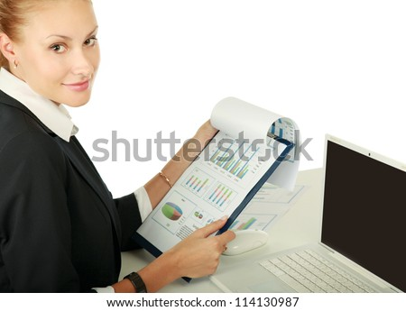 A young woman with a laptop sitting isolated on white background - stock photo