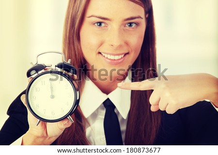 A young woman with alarm clock  - stock photo