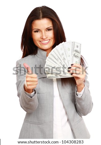 A young woman with dollars in her hands and showin g ok, isolated on white background - stock photo