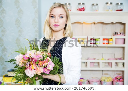 A young woman with the floral composition - stock photo