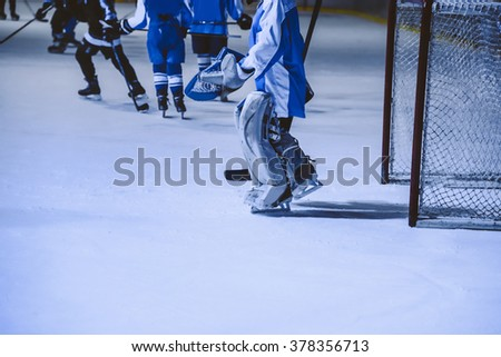 A youth hockey player on the ice. Young boy in hockey equipment - stock photo