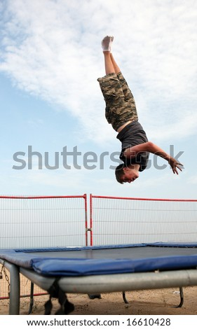 A youth trampolining on the beach at Great Yarmouth, Norfolk, England - stock photo