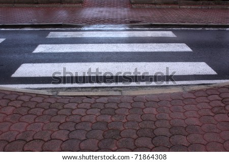 A zebra crossing on a wet, rainy morning - stock photo