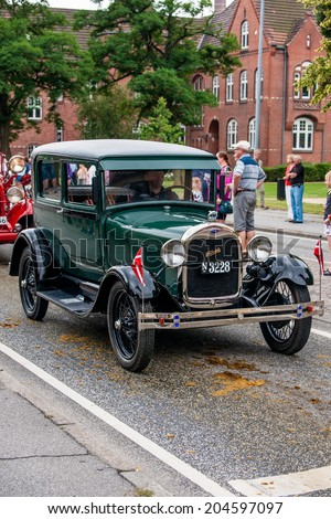 AABENRAA, DENMARK - JULY 6 - 2014: Veteran car at a parade at the annual tilting festival in Aabenraa - stock photo