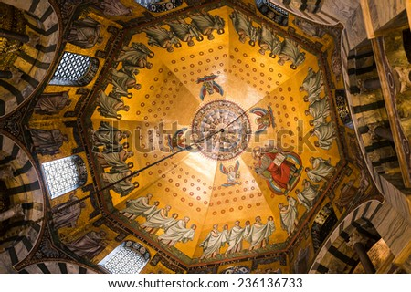 AACHEN, GERMANY - DECEMBER 6, 2013: Beautiful mosaics inside the octagon-shaped interior of the Aachen Cathedral. - stock photo