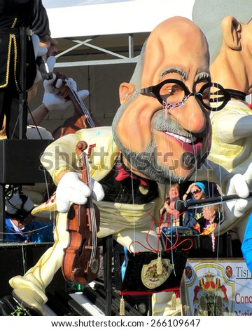 AALST, BELGIUM, 15 FEBRUARY 2015: A caricature of Charles Michel during the famous carnival parade in Aalst. He is the current Prime Minister of Belgium. - stock photo