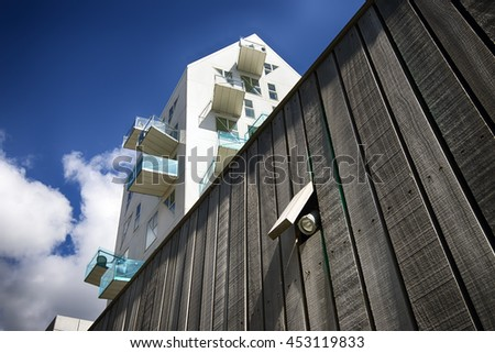 AARHUS, DENMARK - JULY 13, 2016: New modern architecture on Aarhus harbor. The buildings called The Iceberg. Focus on the lamp in the wooden wall. July 13, 2016. - stock photo