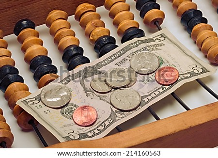 Abakus and currencies american - stock photo