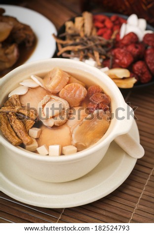 abalone and herb soup in pot, Chinese food style - stock photo