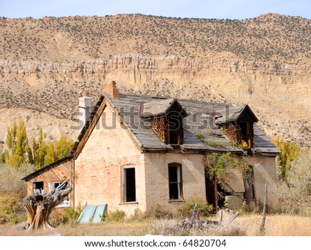 Abandonded Farmhouse in Dying Town - stock photo