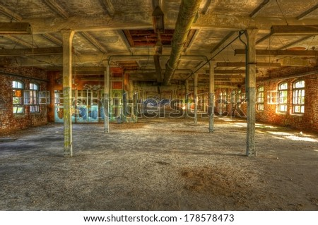 Abandoned administration of an old factory - stock photo