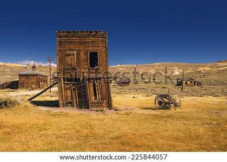 Abandoned and crooked Western building where business was closed after the golden rush. Ruined business in Bodie Ghost Town - stock photo