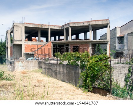 Abandoned and run down half built building - stock photo