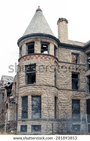 Abandoned apartment building.  This was once a luxury residential address.   - stock photo