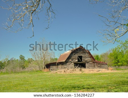 Abandoned barn in pasture - stock photo