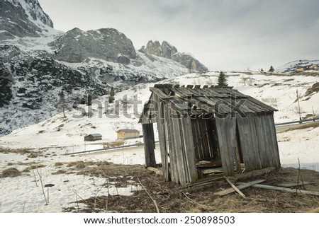Abandoned barn in the mountains - stock photo