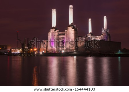 Abandoned Battersea Power Station at night, London, UK  - stock photo