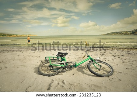 Abandoned bike at the beach  - stock photo