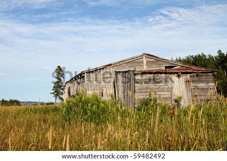 Abandoned building along the south coast of the Gulf of St. Lawrence - stock photo