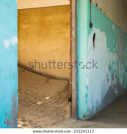 Abandoned building being taken over by encroaching sand, Kolmanskop ghost town, Namib Desert - stock photo