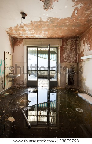 abandoned building, empty room with window - stock photo