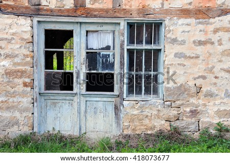 Abandoned building in the Bulgarian village in the springtime - stock photo