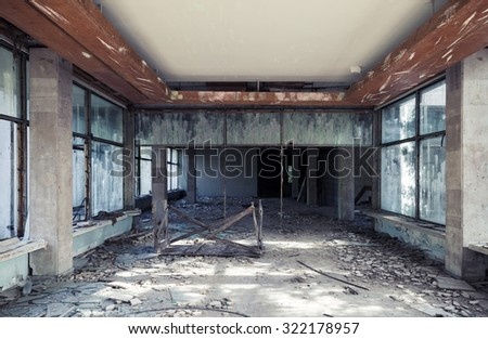 Abandoned building interior. Corridor perspective with dirt on the floor and broken windows. Vintage tonal photo filter effect, old style - stock photo