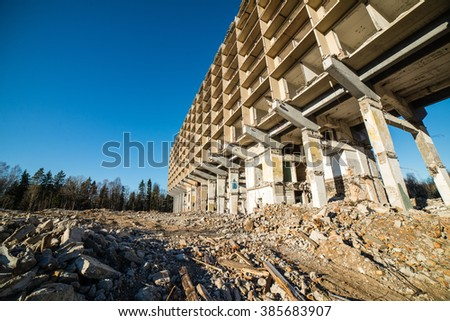 abandoned building ruins on blue sky - stock photo