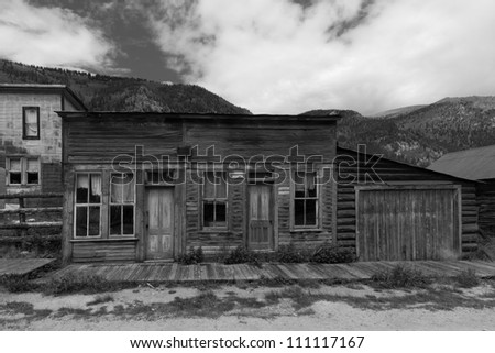 Abandoned Building with Wooden Sidewalk in Western US Ghost Town - stock photo