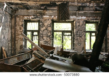 abandoned burnt house - stock photo