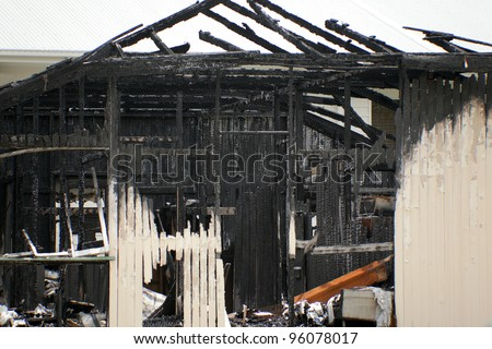 abandoned burnt out house - stock photo