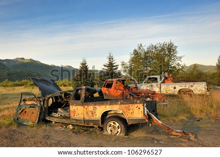 Abandoned cars used as shooting targets. - stock photo