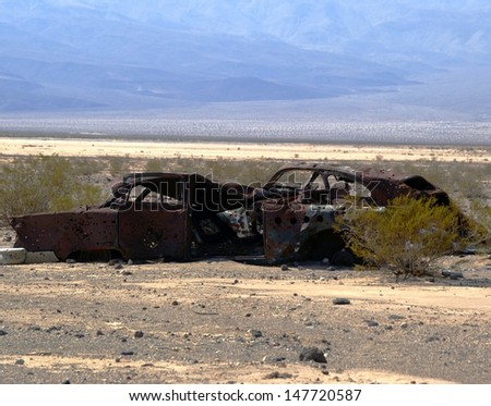 Abandoned Cars with Bullet Holes - Death Valley National Park - California - stock photo