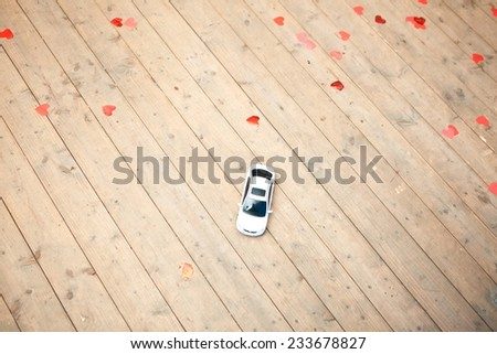 Abandoned children toy cars on the wooden floor - stock photo