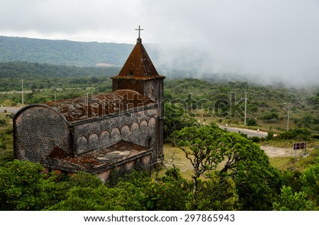 Abandoned christian church on top of Bokor mountain in Preah Monivong national park, Kampot, Cambodia - stock photo