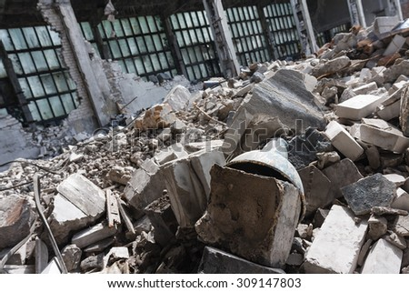 Abandoned destroyed factory building, industrial background - stock photo
