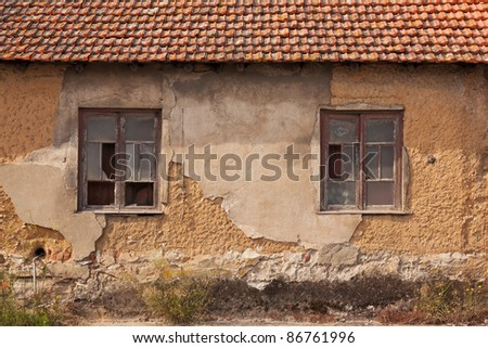 Abandoned facade with wood windows  in Portugal - stock photo