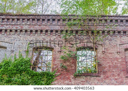 Abandoned factory building. Crumbling Collapsing brick wall, old mortar joints. - stock photo