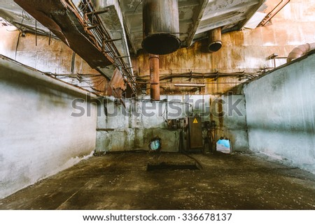 abandoned factory building, rusty pipes - stock photo