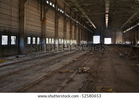 Abandoned factory hall - stock photo