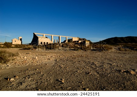 Abandoned factory - rural spanish scenery, dry soil - stock photo