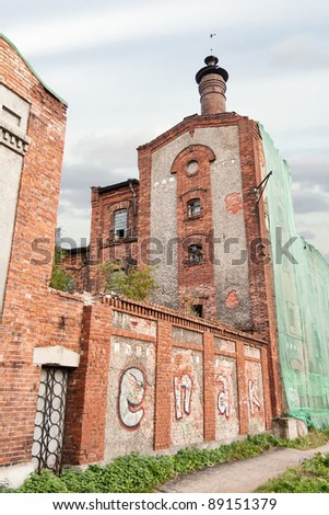 Abandoned factory with graffiti on walls, Arkhangelsk, Russia - stock photo
