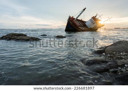 Abandoned fishing boat  - stock photo