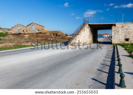 Abandoned food silo ruins against a cloudy sky in Lavrio, greece - stock photo