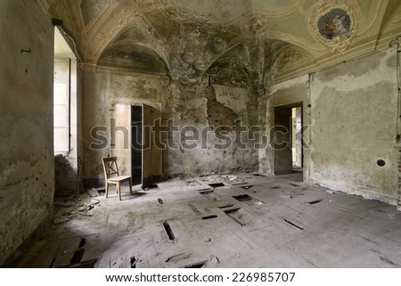 Abandoned frescoed room - stock photo