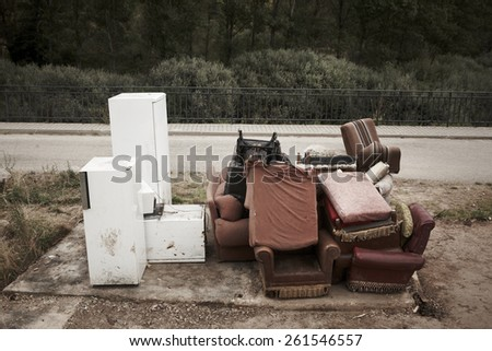 Abandoned furniture and fridges in the street and forest. Horizontal - stock photo