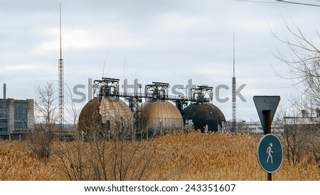 Abandoned gas tanks - stock photo